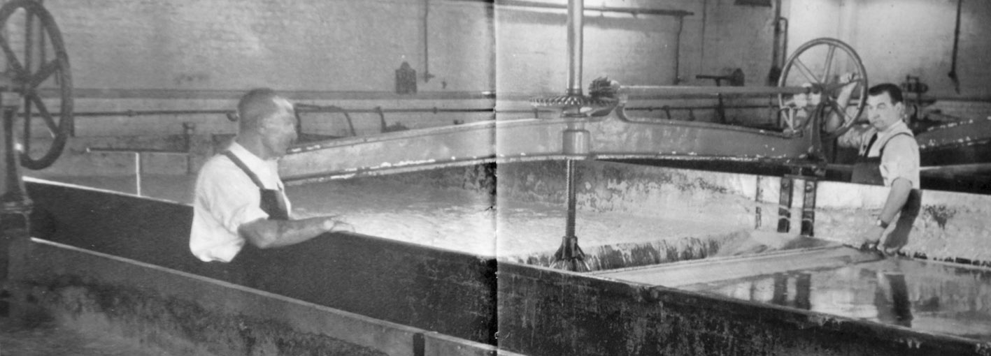 Skimming the yeast from a fermenting vessel, Brick Lane brewery, early 1960s