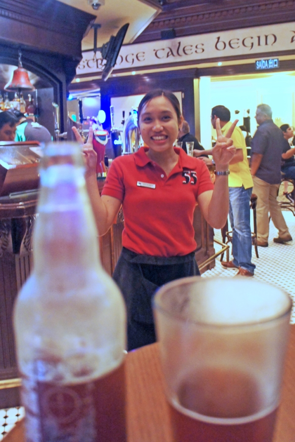 A nice Filipina waitperson demonstrates her delight at MY delight at having found Doom Bar is a bar in Macau