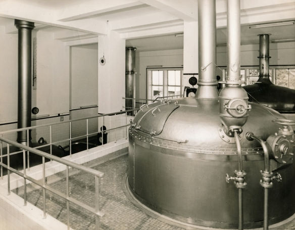 A view of the mash tun at the Sham Tseng brewery in 1959, with the brew kettle visible on the left