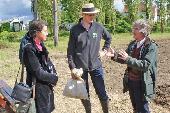 Dr Peter Darby, right, hop expert, talking with Rupert Thompson, centre, and the Reverend Claire Holt of St Pail's, Tongham, who had come to bless the hops and the efforts of the hop-planters