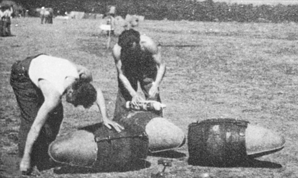 'Beer bombs', wooden firkins being fitted with streamlined 'nose cones' for transporting in bomb racks underneath Spitfires by members of 131 Fighter Wing, probably in August 1944, possibly at Ford airfield in West Sussex. Pictures taken from Polish Wings 15, Wojtek Matusiak, Wydawnictwo Stratus, 2012 p26 and © Straus