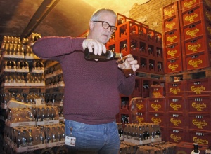 Michael Rahbeck pouring out aged Carlsberg Special Brew