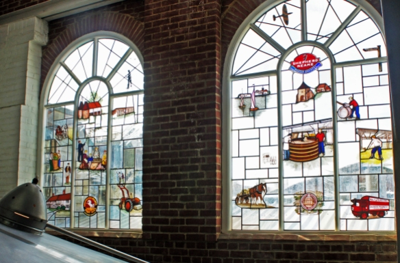 Stained glass windows in the Shepherd Neame brewhouse. Spot the icons, including a bishop's finger signpost, and the Shepherd & Mares trademark