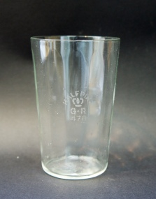 Internally ribbed half-pint conical beaker stamped 'GR 471', for Ayrshire, probably from the 1920s, and almost certainly made by at the Portland Glass Works in Irvine in the style known as 'Venetian'