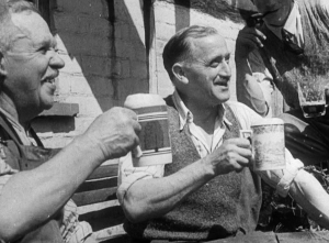 Two men drinking from china pint mugs, from the film Down at the Local, 1945