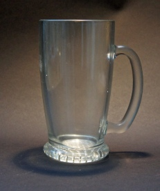 A rare smooth-sided glass pint mug with a lattice design in the foot, stamped with crown and pint but no monartch's initials, and '478' for St Helens, presumably made by Ravenhead