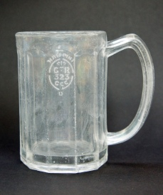 Slightly glass-sick 10-sided half-pint glass stamped 'GR 323' for Gateshead, possibly manufactured by George Davidson & Go of the Teams Glassworks