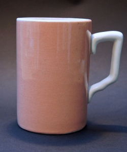 Strawberry pink pint beer mug of the kind George Orwell enjoyed, stamped 'Pint MxCC GR 29', for Middlesex County Council