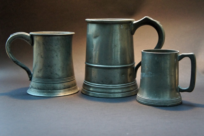 Three Victorian pewter beermugs, pint (stamped James Lashan & Co Glasgow VR with the Official Number 36, for Renfrewshire, in Scotland), quart (stamped VR and G Farmiloe & Son, who were making pewter pots in St John Street, off West Smithfield, in London from 1876: the firm only seems to have ceased in 1940) and unmarked half-pint, with glass bottom. Pewter mugs with glass bottoms are apparently rarely found with stamps, suggesting they were uncommon in pubs, and that the story about having the glass bottom to be able to see the king's shilling is a myth …