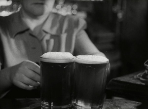 Two pints of mild and bitter, served in ten-sided glasses in a North of England pub in 194, from the film Down at the Local