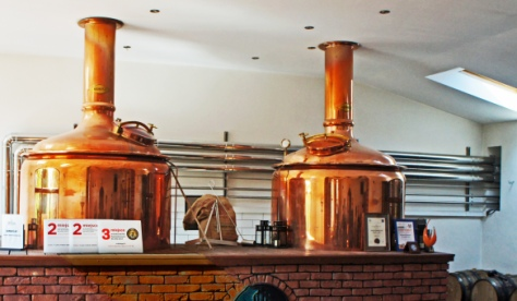 Inside the Widawa restaurant brewery in Chrząstawie Małej – a small village outside Wrocław that Google Translate suggests would be called 'Little Horseradish Pond' in English. On the left is the combined mash tun and copper, on the right the lauter tun.